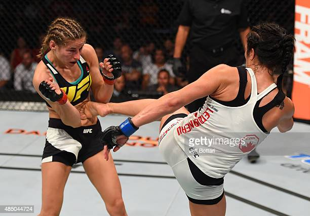 Valerie Letourneau kicks Maryna Moroz of Ukraine in their women's strawweight bout during the UFC event at the SaskTel Centre on August 23 2015 in...