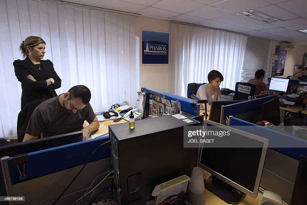 Valerie Maldonado (L), head of the French Anti-Cybercrime Office (OCLCTIC), poses at the PHAROS internet investigation unit in Nanterre, near Paris, on February 4, 2014. PHAROS is part of the French Anti-Cybercrime Office (OCLCTIC).