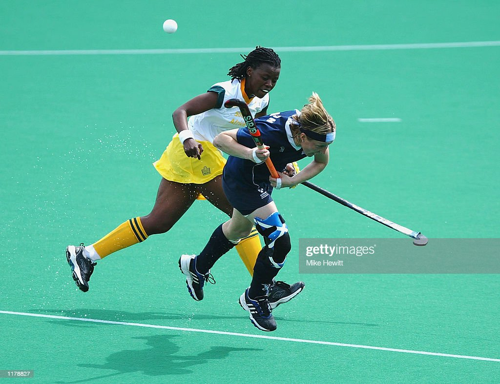 Valerie Thompson of Scotland clashes with Luntu Ntloko of South Africa during the Scotland v South Africa Women's Hockey pool match at the Belle Vue Regional Hockey centre at the 2002 Commonwealth Games in Manchester, England on July 29, 2002.
