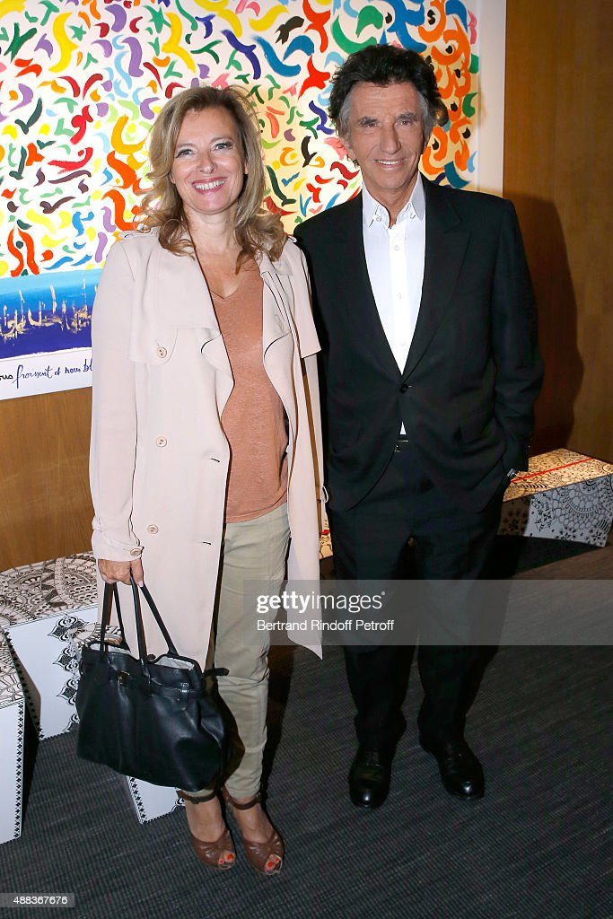 Valerie Trierweiler and Jack Lang attend the 'Paintings Poems from Tahar Ben Jelloun - Furniture Scriptures from C.Saccomanno & O.Dayot' : Press Preview at Galerie du Passage on September 15, 2015 in Paris, France.