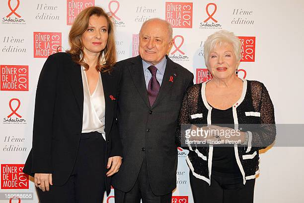Valerie Trierweiler Pierre Berge and Line Renaud pose as they arrive to attend the Sidaction Gala Dinner 2013 at Pavillon d'Armenonville on January...
