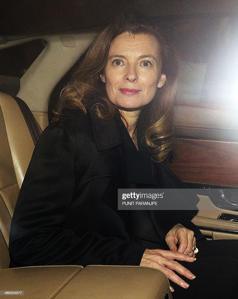 Valerie Trierweiler, the ex-partner of the French President, sits in a car after arriving at the international airport in Mumbai, early on January 27, 2014, for a humanitarian trip to India. Valerie Trierweiler, the ex-partner of French President Francois Hollande arrived in India on a charity mission, days after an announcement that the couple have split. Trierweiler went ahead with the trip to promote a French charity, a charity official said on January 26, in her first public appearance since it emerged that Hollande was having an affair with a French actress.