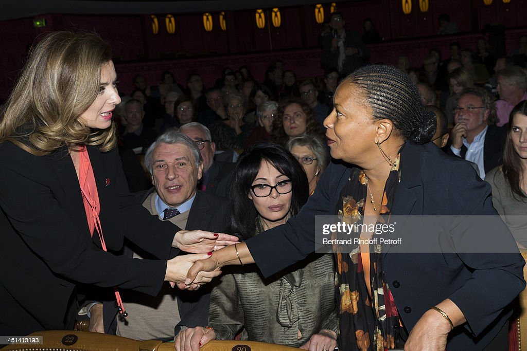 Valerie Trierweiler, the wife of French President Francois Hollande, greets French Justice Minister Christiane Taubira during the award giving ceremony of the Danielle Mitterrand Prize 2013 at La Comedie Des Champs ELysees on November 22, 2013 in Paris, France.