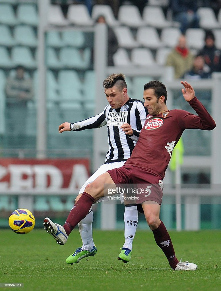 Valerio Di Cesare (R) of Torino FC competes with <a gi-track='captionPersonalityLinkClicked' href=/galleries/search?phrase=Michele+Paolucci&family=editorial&specificpeople=4126121 ng-click='$event.stopPropagation()'>Michele Paolucci</a> of AC Siena during the Serie A match between Torino FC and AC Siena at Stadio Olimpico di Torino on January 13, 2013 in Turin, Italy.