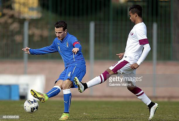 Valerio Verre of Italy U20 battles for the ball with Afif Akram of Qatar U20 during the international friendly match between Italy U20 and Qatar U20...
