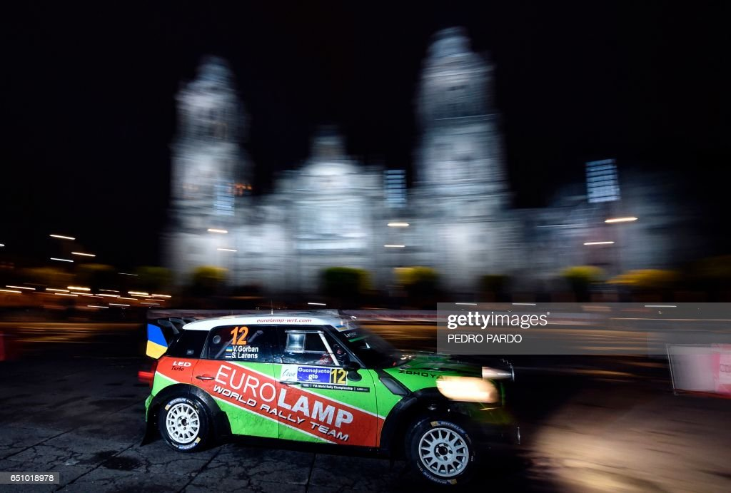 Valeriy Gorban of Ukraine and his co-driver Sergei Larens of Estonia compete in their BMW-Mini John Cooper Works during the street stage on the first day of the FIA World Rally Championship's in Me...