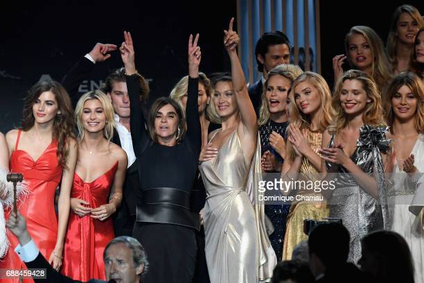 Valery Kaufman Hailey Baldwin Carine Roitfeld Bella Hadid Natasha Poly Elsa Hosk Hana Jirickova and Camila Morrone are seen on stage at the amfAR...