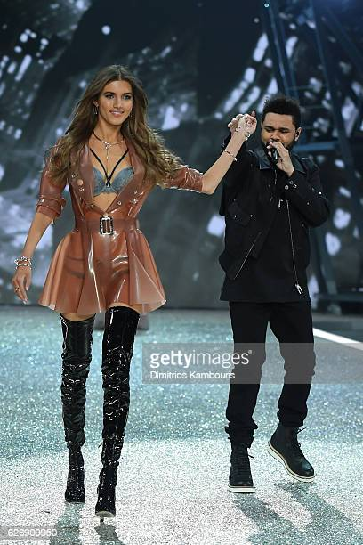 Valery Kaufman walks the runway next to The Weeknd performing during the 2016 Victoria's Secret Fashion Show on November 30 2016 in Paris France