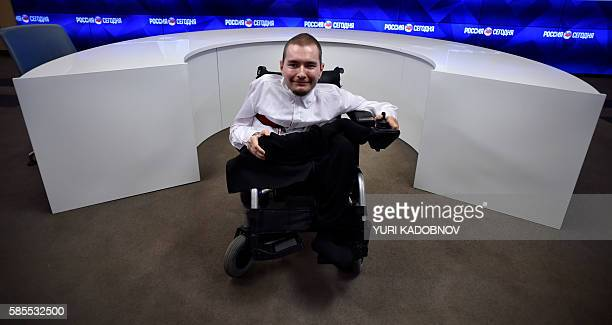 Valery Spiridonov a 31yearold Russian graphic artist looks on during a press conference on 'Autopilot system for wheelchairs' on August 3 2016 in...