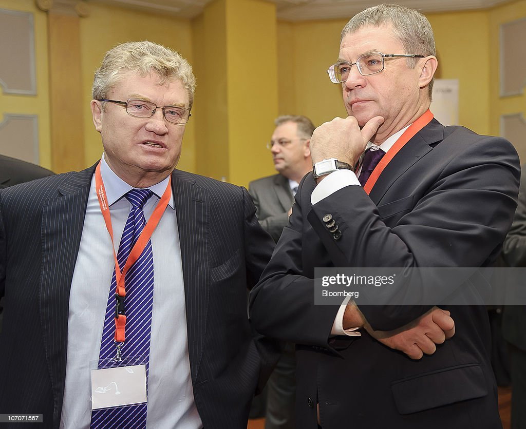Valery Yazev, president of the Russian Gas Association, left, speaks with <a gi-track='captionPersonalityLinkClicked' href=/galleries/search?phrase=Alexander+Medvedev&family=editorial&specificpeople=671477 ng-click='$event.stopPropagation()'>Alexander Medvedev</a>, deputy chief executive officer of OAO Gazprom, during the European Union (EU) - Russia Energy conference, at the Metropole Hotel, in Brussels, Belgium, on Monday, Nov. 22, 2010. Russia�s natural gas monopoly OAO Gazprom expects a balanced gas market by 2015, Medvedev said today. Photographer: Jock Fistick/Bloomberg via Getty Images
