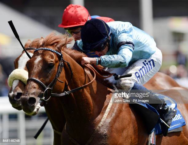 Valiant and Ryan Moore get up to beat Silver Blaze and PJ McDonald to win the Neptune Investment Management Stakes on Mid Summer Raceday during the...