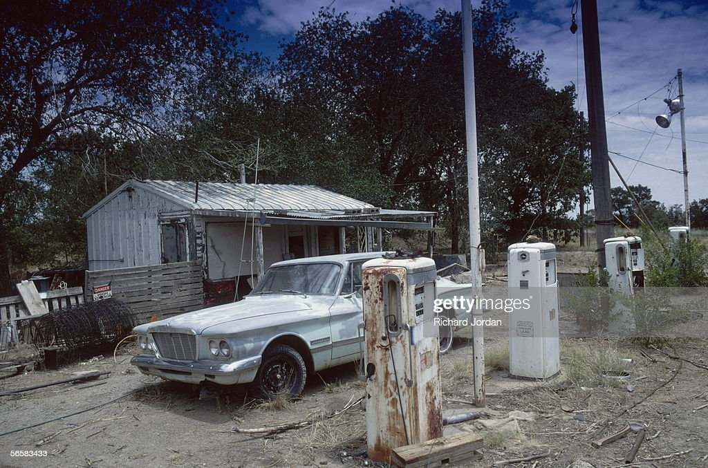 Valiant parked at a deserted gas station in Tijeras, New Mexico, one of the stops along Historic Route 66, 1989.