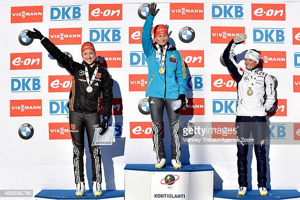 Valj Semerenko of Ukraine takes 1st place Franziska Preuss of Germany takes 2nd place Karin Oberhofer of Italy takes 3rd place during the IBU...