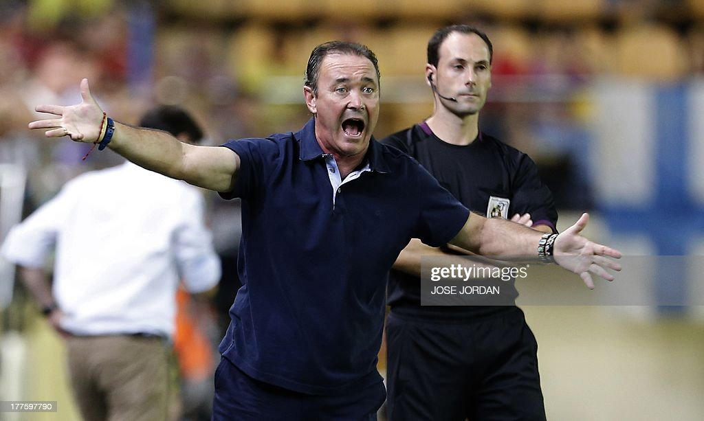 Valladolid's coach Juan Ignacio Martinez reacts during the Spanish league football match Villarreal CF vs Real Valladolid FC de Madrid at El Madrigal stadium in Villareal on August 24, 2013.