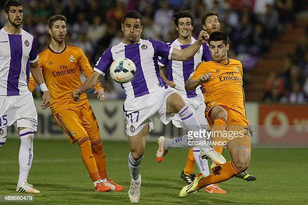 Valladolid's defender Carlos Pena vies with Real Madrid's forward Alvaro Morata during the Spanish league football match Real Valladolid FC vs Real...