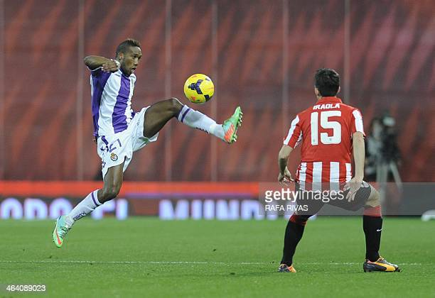 Valladolid's French defender Zakarya Bergdich vies with Athletic Bilbao's defender Andoni Iraola during the Spanish league football match Athletic...