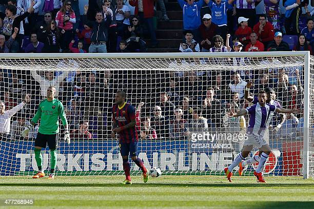 Valladolid's Italian midfielder Fausto Rossi celebrates after scoring as Barcelona's goalkeeper Victor Valdes reacts during the Spanish league...