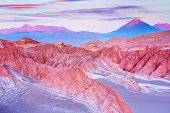 """Valle de la Muerte with Volcan Licancabur in the Atacama Desert, northern Chile, at sunset."""