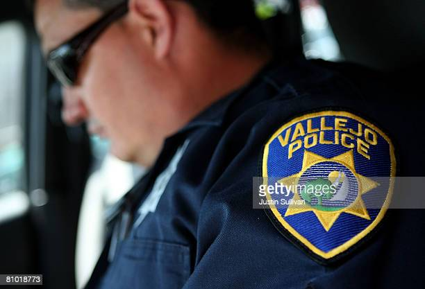 Vallejo Police Department Corporal John Garcia goes over paperwork in his patrol car as he gets ready to patrol the streets May 7 2008 in Vallejo...