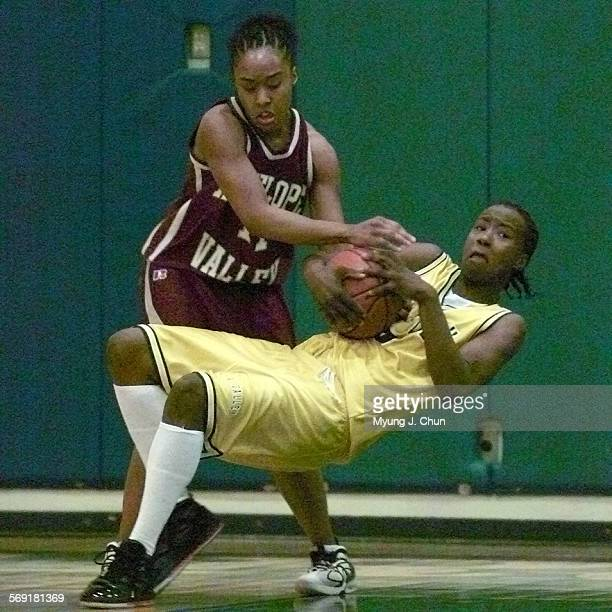 Valley College's Tynisha Howze wins the battle of the possession against Antelope Valley's Ebony Sullivan during first half action Saturday night...