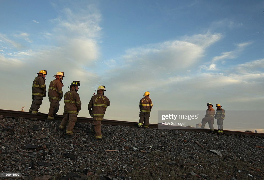 Valley Mills Fire Department personnel view the railroad tracks near to the fertilizer plant that exploded yesterday afternoon on April 18, 2013 in West, Texas. According to West Mayor Tommy Muska, around 14 people, including 10 first responders, were killed and more than 150 people were injured when the fertilizer company caught fire and exploded, leaving damaged buildings for blocks in every direction.