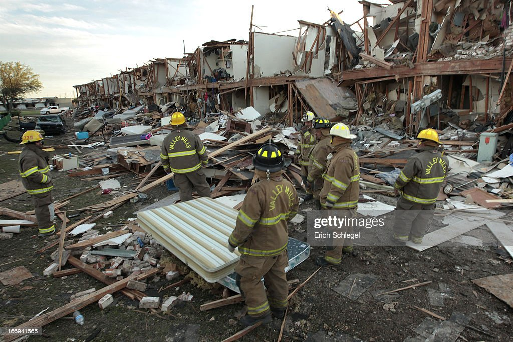 Valley Mills Fire Department personnel walk among the remains of an apartment complex next to the fertilizer plant that exploded yesterday afternoon on April 18, 2013 in West, Texas. According to West Mayor Tommy Muska, around 14 people, including 10 first responders, were killed and more than 150 people were injured when the fertilizer company caught fire and exploded, leaving damaged buildings for blocks in every direction.
