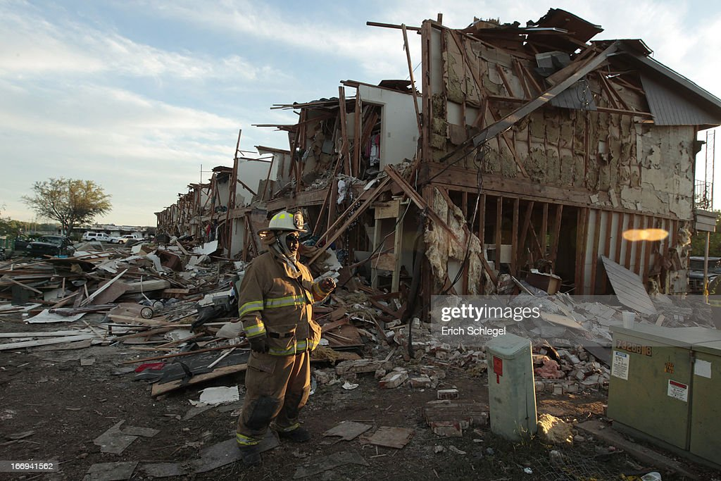 A Valley Mills Fire Department personnel walks among the remains of an apartment complex next to the fertilizer plant that exploded yesterday afternoon on April 18, 2013 in West, Texas. According to West Mayor Tommy Muska, around 14 people, including 10 first responders, were killed and more than 150 people were injured when the fertilizer company caught fire and exploded, leaving damaged buildings for blocks in every direction.