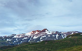 Valley National Park Landmannalaugar. On the gentle slopes of the mountains are snow fields and glaciers