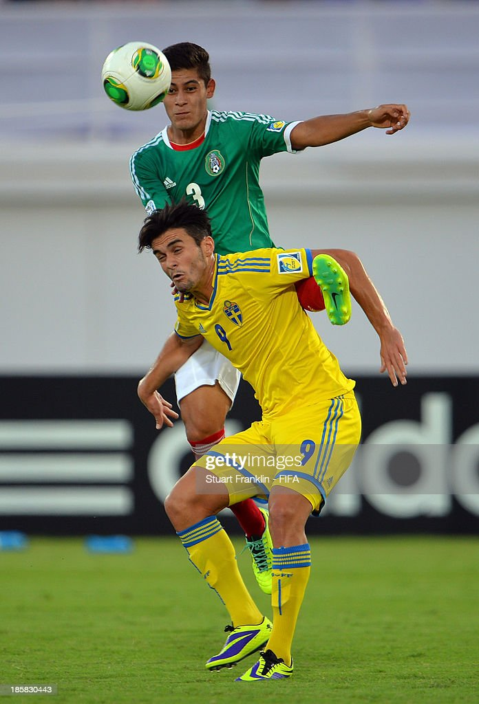 Valmir Berisha of Sweden is challenged by Salomon Wbias of Mexico during the FIFA U 17 World Cup group F match between Sweden and Mexico at Khalifa Bin Zayed Stadium on October 25, 2013 in Al Ain, United Arab Emirates.