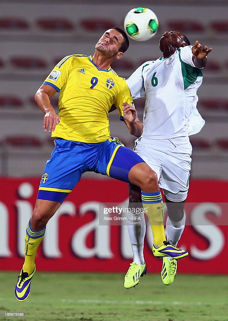 Valmir Berisha (L) of Sweden jumps for a header with Aliyu Abubakar of Nigeria during the FIFA U-17 World Cup UAE 2013 Semi Final match between Sweden and Nigeria at Al Rashid Stadium on November 5, 2013 in Dubai, United Arab Emirates.