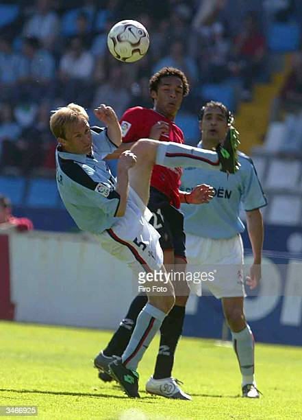 Valmiro Valdo of Osasuna dodges Everton Giovanella of Celta during the Primera liga match between Celta and Osasuna on April 25 2004 at the Balaidos...