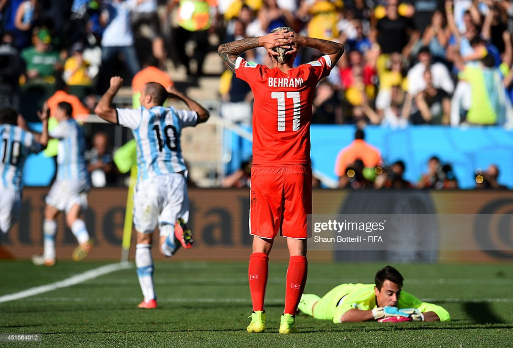 <a gi-track='captionPersonalityLinkClicked' href=/galleries/search?phrase=Valon+Behrami&family=editorial&specificpeople=453450 ng-click='$event.stopPropagation()'>Valon Behrami</a> (2nd R) and <a gi-track='captionPersonalityLinkClicked' href=/galleries/search?phrase=Diego+Benaglio&family=editorial&specificpeople=543817 ng-click='$event.stopPropagation()'>Diego Benaglio</a> (1st R) of Switzerland react after conceding the first goal to Argentina during the 2014 FIFA World Cup Brazil Round of 16 match between Argentina and Switzerland at Arena de Sao Paulo on July 1, 2014 in Sao Paulo, Brazil.