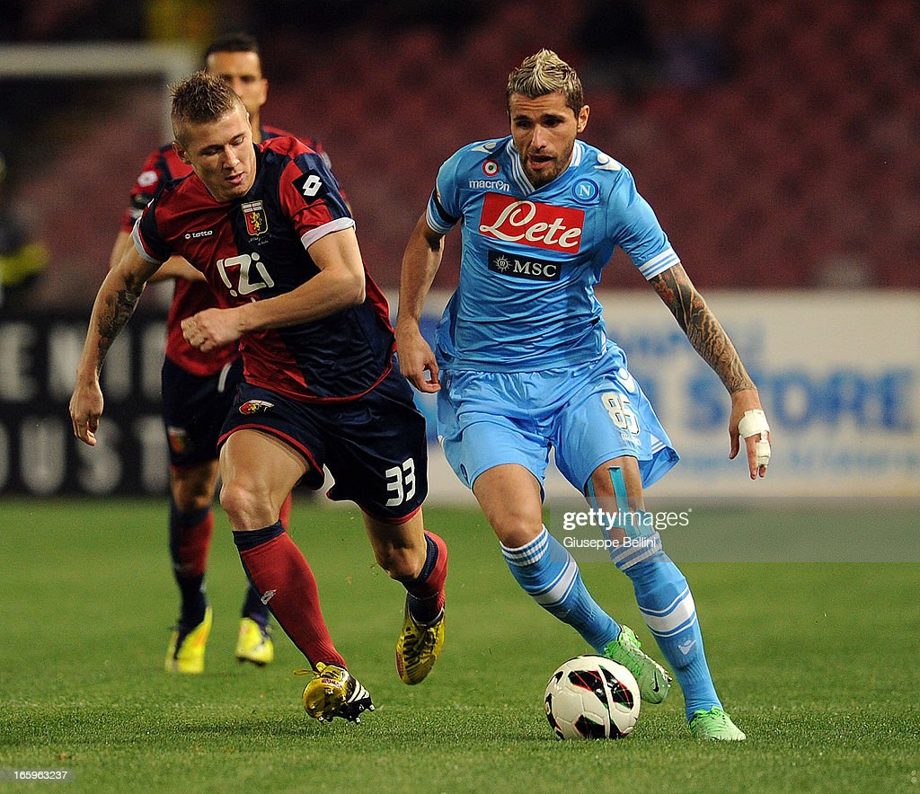 <a gi-track='captionPersonalityLinkClicked' href=/galleries/search?phrase=Valon+Behrami&family=editorial&specificpeople=453450 ng-click='$event.stopPropagation()'>Valon Behrami</a> (L) of Genoa and <a gi-track='captionPersonalityLinkClicked' href=/galleries/search?phrase=Goran+Pandev&family=editorial&specificpeople=800427 ng-click='$event.stopPropagation()'>Goran Pandev</a> of Napoli in action during the Serie A match between SSC Napoli and Genoa CFC at Stadio San Paolo on April 7, 2013 in Naples, Italy.