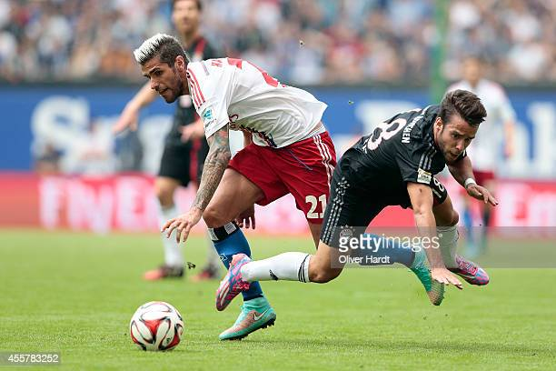 Valon Behrami of Hamburg and Juan Bernat of Munich compete for the ball during the Bundesliga match between Hamburger SV and FC Bayern Muenchen at...