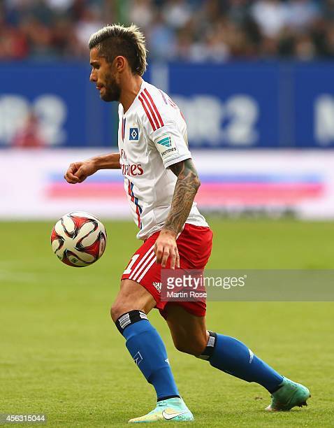 Valon Behrami of Hamburg runs with the ball during the Bundesliga match between Hamburger SV and Eintracht Frankfurt at Imtech Arena on September 28...