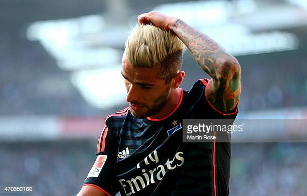 Valon Behrami of Hamburg walks off dejected off the pitch during the Bundesliga match between SV Werder Bremen and Hamburger SV at Weserstadion on...