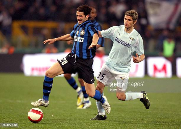 Valon Behrami of Lazio vies with Christian Chivu of Inter during the Serie A match between Lazio and Inter Milan at the Stadio Olimpico on March 29...