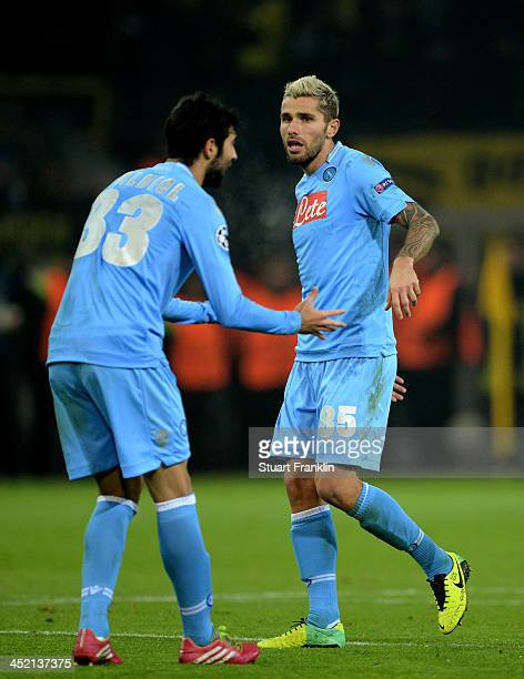 Valon Behrami of Napoli celebrates the Napoli goal scored by Lorenzo Insigne with Raul Albiol during the UEFA Champions League Group F match between...