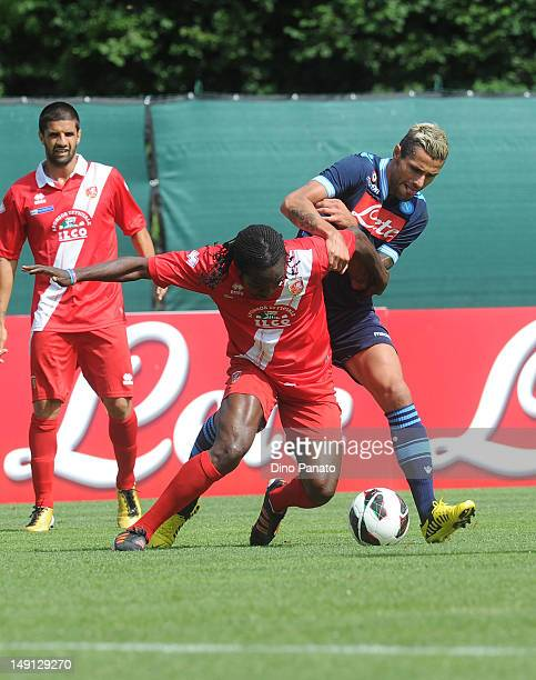 Valon Behrami of Napoli competes with Kenneth Obodo of Grosseto during the preseason friendly match between SSC Napoli and US Grosseto on July 23...