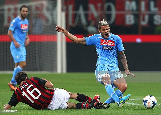 Valon Behrami of SSC Napoli competes for the ball with Andrea Poli of AC Milan during the Serie A match between AC Milan and SSC Napoli at San Siro...