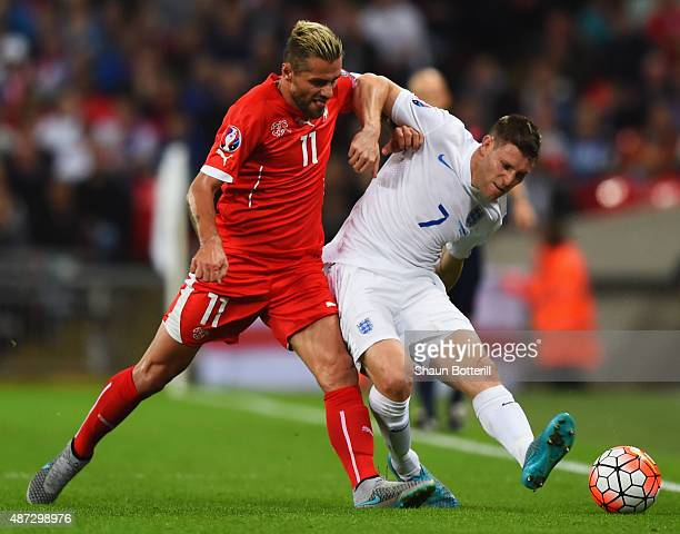 Valon Behrami of Switzerland and James Milner of England tussle for the ball during the UEFA EURO 2016 Group E qualifying match between England and...