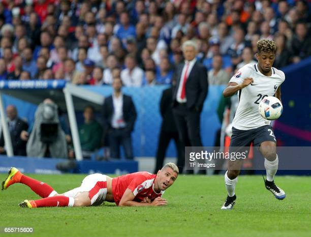 Valon Behrami of Switzerland and Kingsley Coman of France battle for the ball during the UEFA Euro 2016 Group A match between the Switzerland and...
