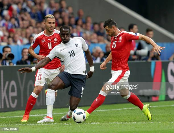 Valon Behrami of Switzerland and Moussa Sissoko of France and Blerim Dzemaili of Switzerland battle for the ball during the UEFA Euro 2016 Group A...