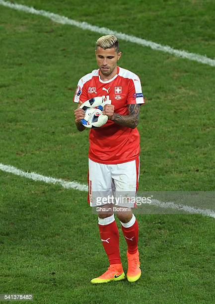 Valon Behrami of Switzerland holds the burst ball during the UEFA EURO 2016 Group A match between Switzerland and France at Stade PierreMauroy on...