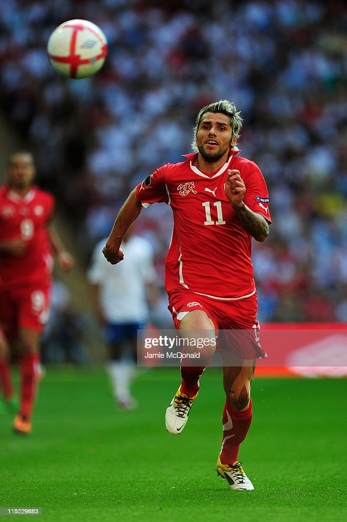 <a gi-track='captionPersonalityLinkClicked' href=/galleries/search?phrase=Valon+Behrami&family=editorial&specificpeople=453450 ng-click='$event.stopPropagation()'>Valon Behrami</a> of Switzerland in action during the UEFA EURO 2012 group G qualifying match between England and Switzerland at Wembley Stadium on June 4, 2011 in London, England.