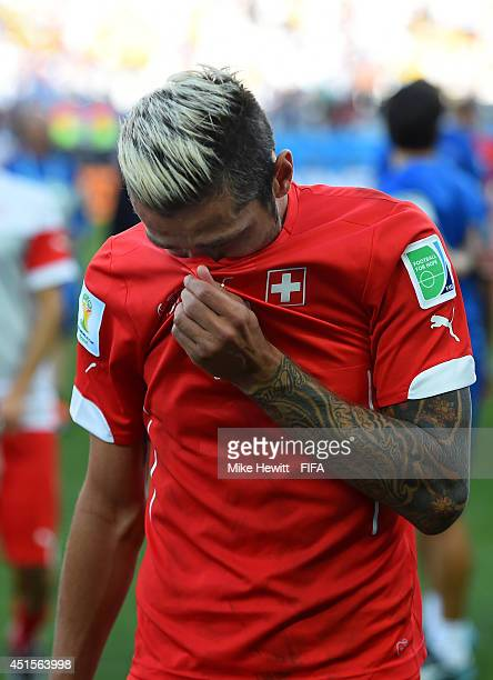 Valon Behrami of Switzerland shows his dejection as he walks off the pitch after the 01 defeat in the 2014 FIFA World Cup Brazil Round of 16 match...