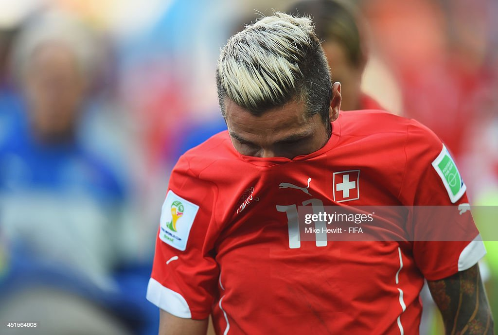 <a gi-track='captionPersonalityLinkClicked' href=/galleries/search?phrase=Valon+Behrami&family=editorial&specificpeople=453450 ng-click='$event.stopPropagation()'>Valon Behrami</a> of Switzerland shows his dejection as he walks off the pitch after the 0-1 defeat in the 2014 FIFA World Cup Brazil Round of 16 match between Argentina and Switzerland at Arena de Sao Paulo on July 1, 2014 in Sao Paulo, Brazil.