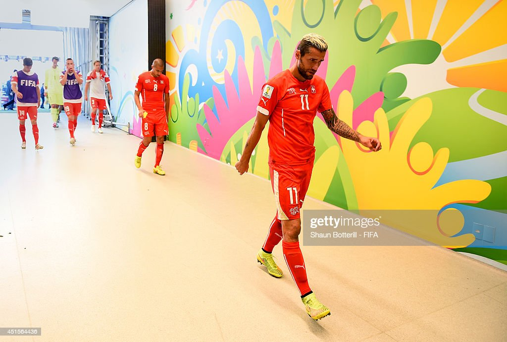 <a gi-track='captionPersonalityLinkClicked' href=/galleries/search?phrase=Valon+Behrami&family=editorial&specificpeople=453450 ng-click='$event.stopPropagation()'>Valon Behrami</a> of Switzerland shows his dejection in the tunnel after the 0-1 defeat in the 2014 FIFA World Cup Brazil Round of 16 match between Argentina and Switzerland at Arena de Sao Paulo on July 1, 2014 in Sao Paulo, Brazil.
