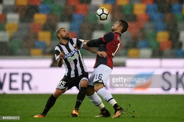 Valon Behrami of Udinese and Andrey Galabinov of Genoa compete for the ball during the Serie A match between Udinese Calcio and Genoa CFC at Stadio...