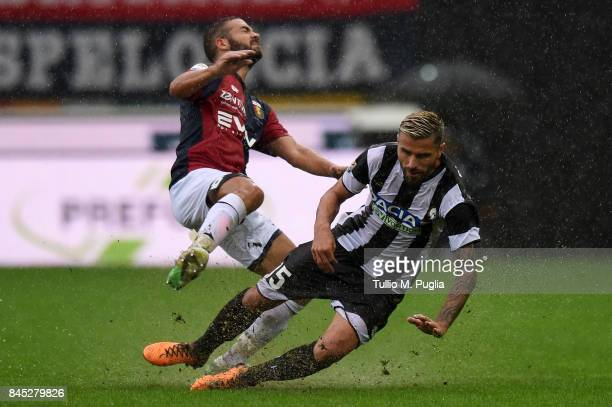 Valon Behrami of Udinese fouls Davide Biraschi of Genoa during the Serie A match between Udinese Calcio and Genoa CFC at Stadio Friuli on September...